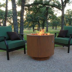 """Fire Pits - Great for Fall and Winter - With a similar design to our 30"""" Round Cor-Ten steel fire pit, this fire pit has an access door on the side of the fire pit to easily remove and place a standard 20 lbs. propane tank. Propane tank is accessed thru door with brass thumb screws. This fire pit accepts a standard 20 lbs. propane tank. This modern fire pit comes with a propane tank regulator, key valve, no whistle flex line and 18"""" burner ring."""