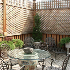 Traditional Patio by Benvenuti and Stein
