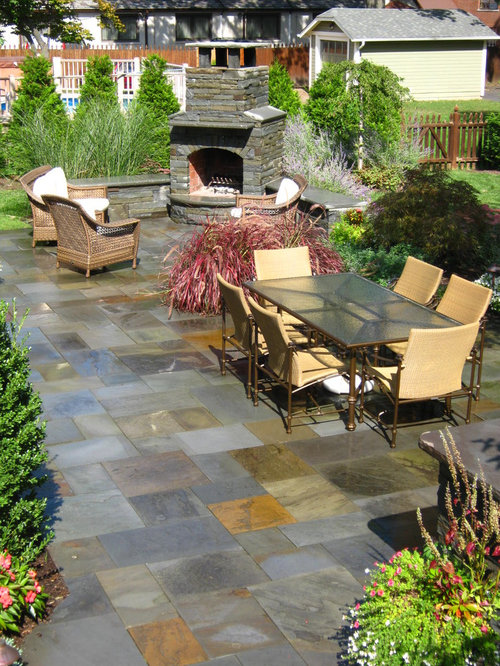 Large Elegant Backyard Tile Patio Photo In New York With A Fire Pit