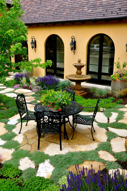 Mediterranean Patio by Designscapes Colorado Inc.