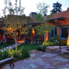 Mediterranean Patio by Designscapes Colorado Inc.