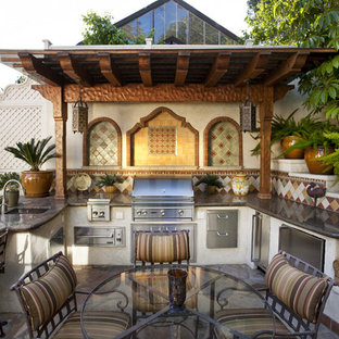 Mediterranean patio in Los Angeles with an outdoor kitchen and a pergola.