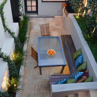 Imagen de patio actual, pequeño, en patio, con jardín vertical