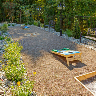 Large country backyard patio in Philadelphia with gravel.