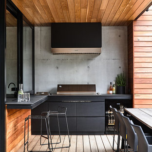 Photo of a contemporary patio in Melbourne with an outdoor kitchen, decking and a roof extension.