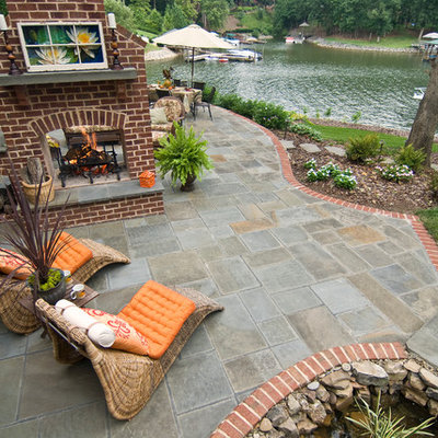 Inspiration for a transitional patio remodel in Charlotte with a fire pit
