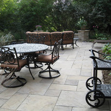 Traditional Patio by Designing Nature Inc.