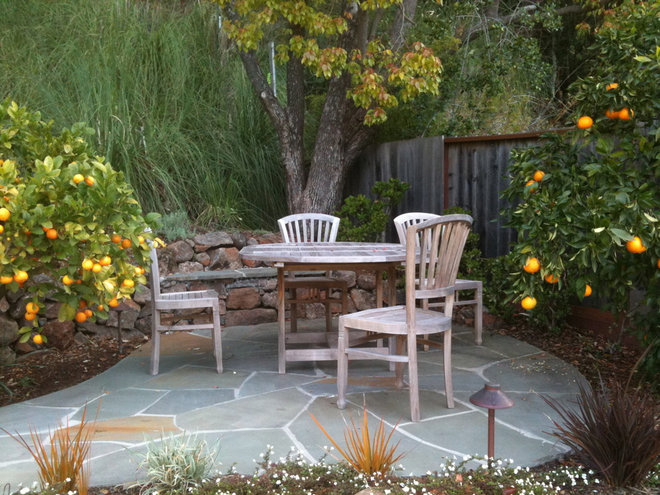 Eclectic Patio by Gardens & Gables