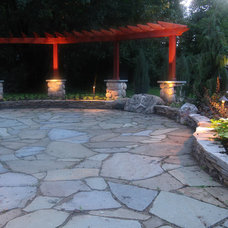 Patio by Treasured Earth Landscaping