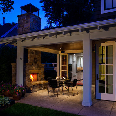Patio - traditional patio idea in Other with a fire pit