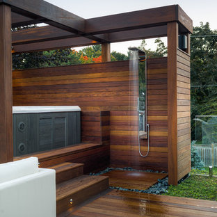 Design ideas for a mid-sized contemporary backyard patio in Toronto with an outdoor shower and no cover.
