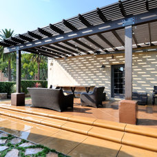 Rustic Patio by Luxe Design Build