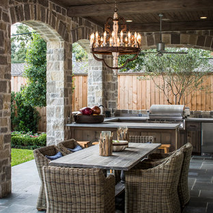 Classic patio in Houston with an outdoor kitchen.
