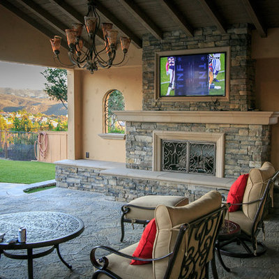 Inspiration for a large timeless backyard concrete paver patio kitchen remodel in San Diego with a pergola