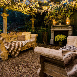 Mid-sized cottage chic backyard gravel patio photo in Other with a fire pit and a pergola