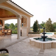 Mediterranean Patio by Brentwood Construction and Remodeling