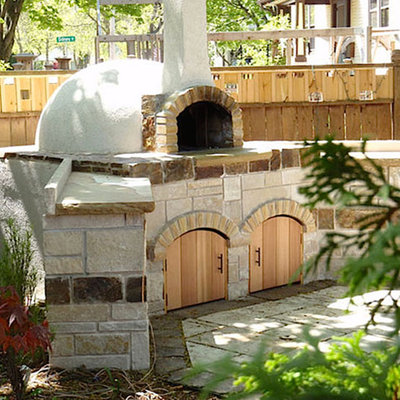 Inspiration for a mid-sized southwestern backyard concrete paver patio kitchen remodel in Portland