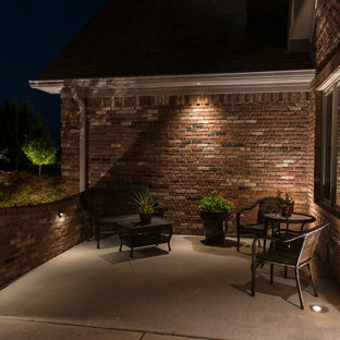 Inspiration for a mid-sized timeless front yard concrete patio remodel in Indianapolis with no cover