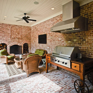 Patio - traditional brick patio idea in Houston