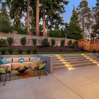 Patio - contemporary patio idea in Seattle with a fire pit and no cover