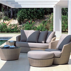 Brown Wicker Sofa and Lounge - Outdoor wicker sofa and lounge chair ensemble made of synthetic wicker.