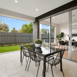 Inspiration for a contemporary backyard patio in Adelaide with a roof extension.