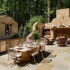 Rustic Patio by Landscape Design Group Inc.