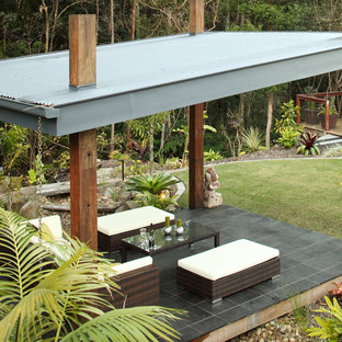 Example Of An Island Style Patio Design In Sunshine Coast With A Gazebo