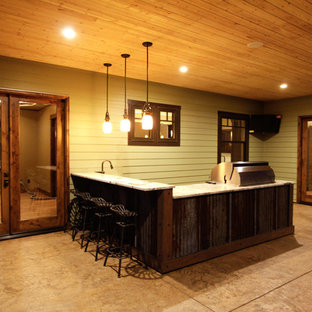 Design ideas for an expansive shabby-chic style back patio in Other with an outdoor kitchen and stamped concrete.