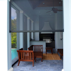 built in titan screens on lanai with outdoor kitchen