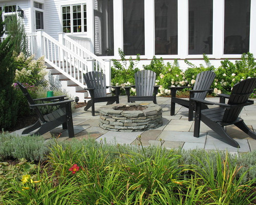 Inspiration For A Timeless Side Yard Stone Patio Remodel In Burlington With  A Fire Pit