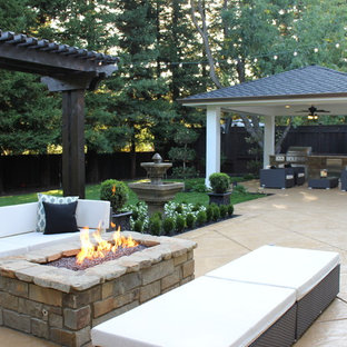 Elegant backyard patio photo in San Francisco with a gazebo and a fire pit