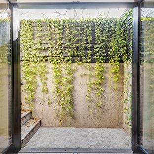 Idee per un patio o portico industriale di medie dimensioni