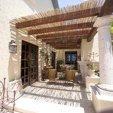 Mediterranean Patio by Djuna Design Studio