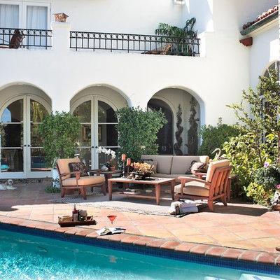 Patio - mediterranean patio idea in Los Angeles with no cover