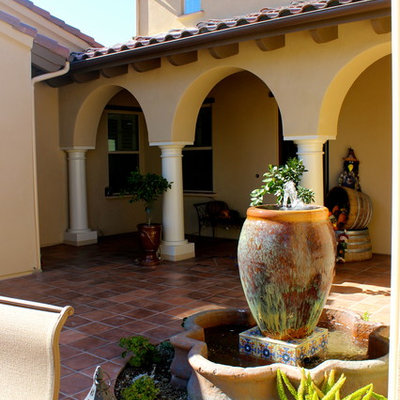 Tuscan tile patio fountain photo in Los Angeles with no cover