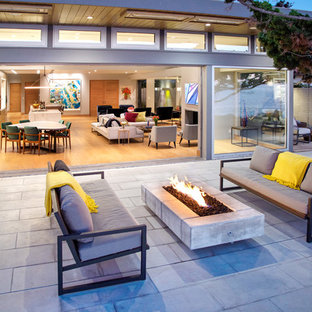 Inspiration for a contemporary patio remodel in Orange County with no cover