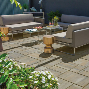 Inspiration for a mid-sized contemporary backyard concrete paver patio remodel in Philadelphia