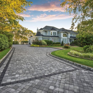 Large transitional front yard concrete paver patio photo in New York with no cover