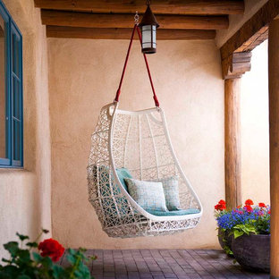 Patio - southwestern patio idea in Albuquerque with a roof extension