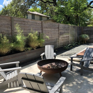 Inspiration For A 1950s Backyard Concrete Patio Remodel In Austin With A  Fire Pit
