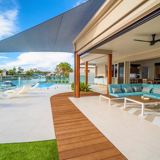Inspiration for a mid-sized contemporary backyard patio in Sunshine Coast with a roof extension.