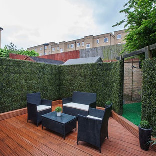Inspiration for a transitional backyard patio remodel in London with decking