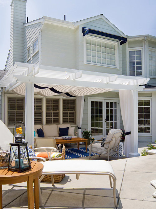 Example Of A Large Coastal Backyard Stamped Concrete Patio Design In Los Angeles With Pergola