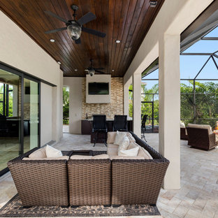 Expansive mediterranean back patio in Orlando with an outdoor kitchen and natural stone paving.
