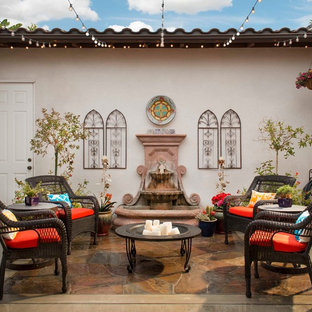 Photo of a bohemian patio in San Diego with a water feature and no cover.