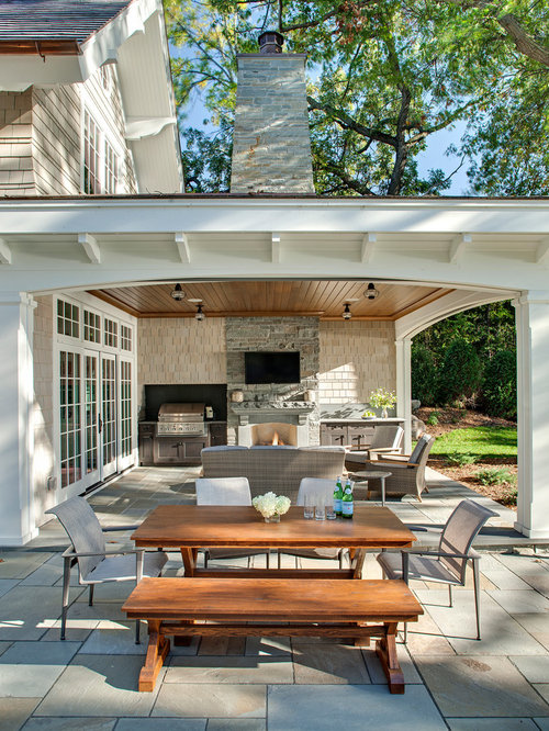 Inspiration For A Timeless Backyard Stone Patio Remodel In Minneapolis With  A Roof Extension And A