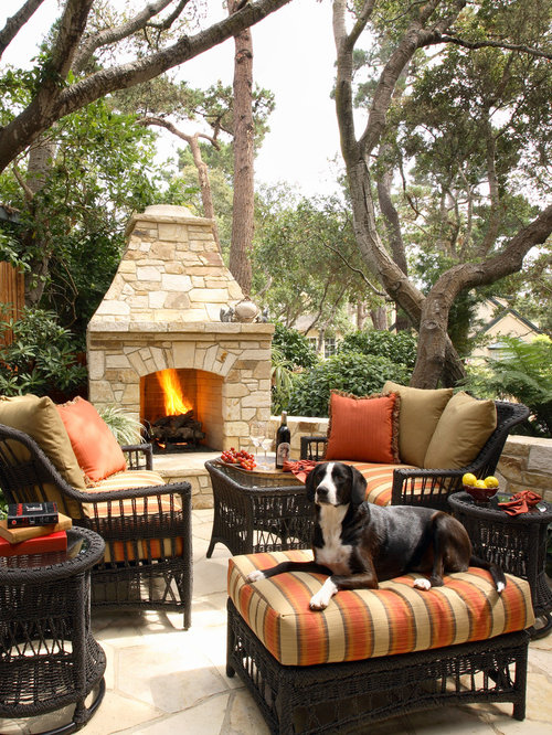 Outdoor Fireplace Design Ideas tiny chairs and square table on usual floortile near outdoor stone fireplace between logponds Inspiration For A Timeless Backyard Patio Remodel With A Fire Feature