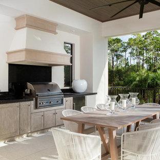 Mediterranean patio in Miami with an outdoor kitchen.