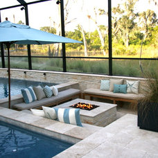 Traditional Patio by Coastal Luxury Outdoors